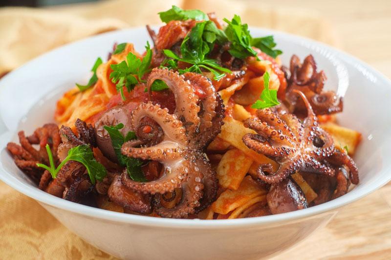 Italian tagliatelle con polpo grilled Octopus in tomato spaghetti sauce